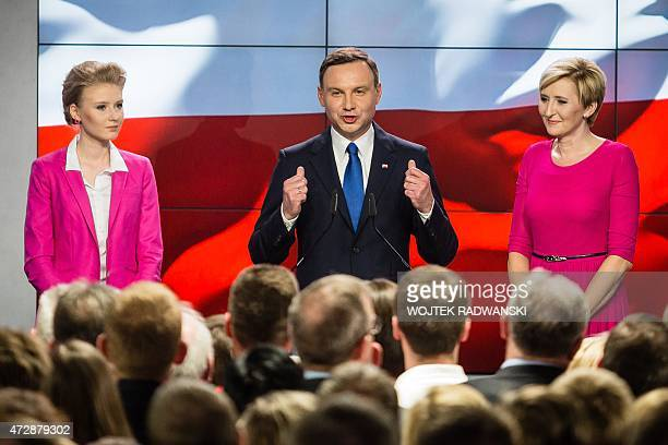 Andrzej Duda presidential candidate of Law and Justice right wing opposition party addresses his supporters next to his wife Agata and daughter Kinga...