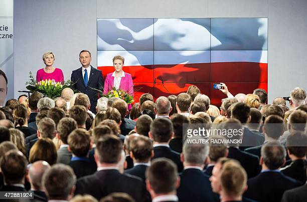 Andrzej Duda presidential candidate of Law and Justice right wing opposition party and his wife Agata and daughter Kinga are seen just after first...