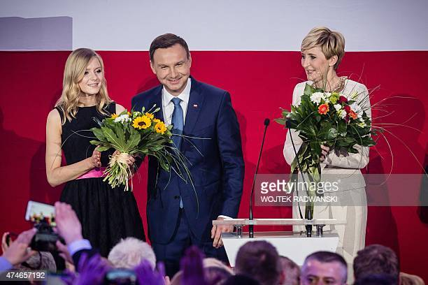 Andrzej Duda presidential candidate of Law and Justice right wing opposition party celebrates with his wife Agata and daughter Kinga after the...