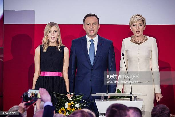 Andrzej Duda presidential candidate of Law and Justice right wing opposition party sings the national anthem with his wife Agata and daughter Kinga...