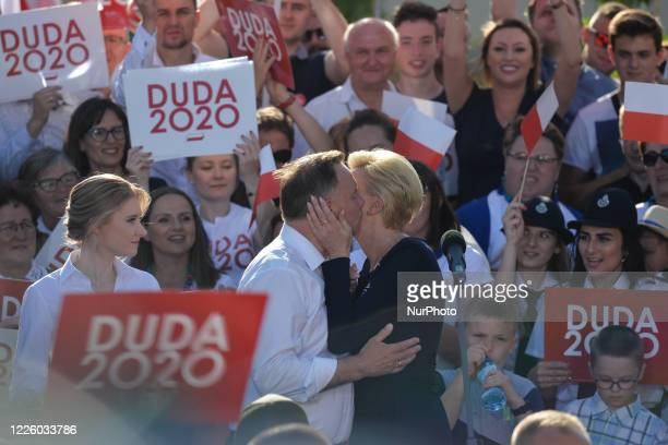 Andrzej Duda the current Polish President and candidate for the presidential election 2020 receives a kiss from his wife Agata watched by his...