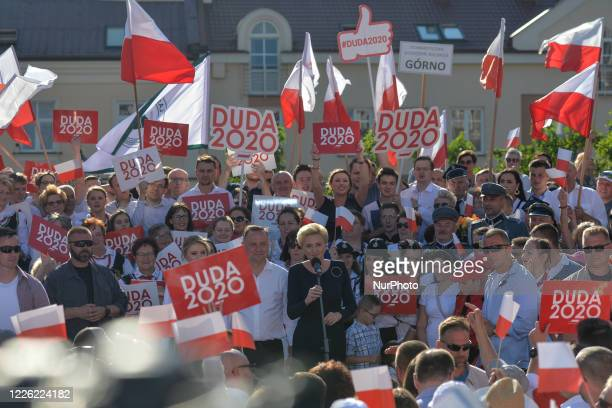 Andrzej Duda the current Polish President and candidate for the presidential election 2020 and his daughter Kinga listen his wife Agata addressing...