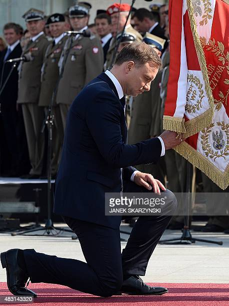 Andrzej Duda the new Polish president knees as he takes over command of the Polish armed forces at a ceremony at Pilsudski Square in Warsaw on August...