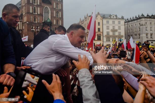 Andrzej Duda, the rulling President of Poland backed by the governing right-wing Law and Justice party greets locals and supporters during a...