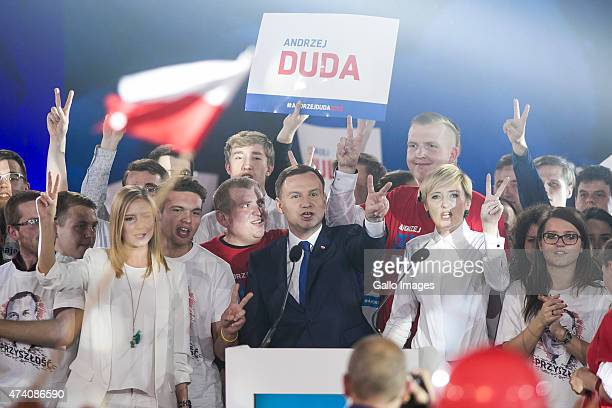 Andrzej Duda with his wife Agata and daughter Kinga greet supporters at a press conference as part of his campaign on May 20 2015 in Warsaw Poland...