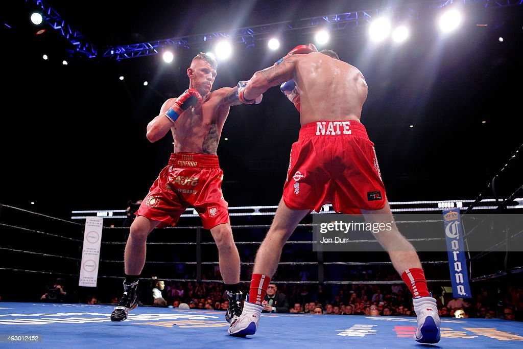 Andrzej Fonfara (L) and Nathan Cleverly (R) exchange punches during their Main Event: Light Heavyweights fight at UIC Pavilion on October 16, 2015 in Chicago, Illinois. Andrzej Fonfara won by unanimous decision.