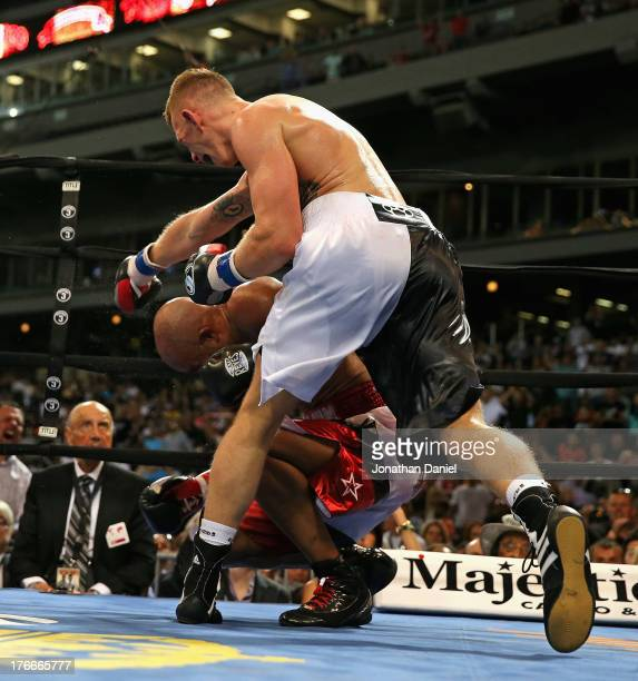 Andrzej Fonfara knocks down Gabriel Campillo for a knock out win during an outdoor boxing event at US Cellular Field on August 16 2013 in Chicago...