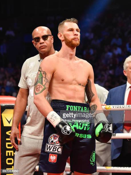 Andrzej Fonfara looks on against Adonis Stevenson with his coach Virgil Hunter standing behind him during the WBC light heavyweight world...