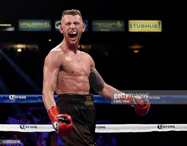 Andrzej Fonfara reacts to his TKO over Julio Cesar Chavez Jr during the ninth round to win the WBC light heavyweight title fight at StubHub Center on...