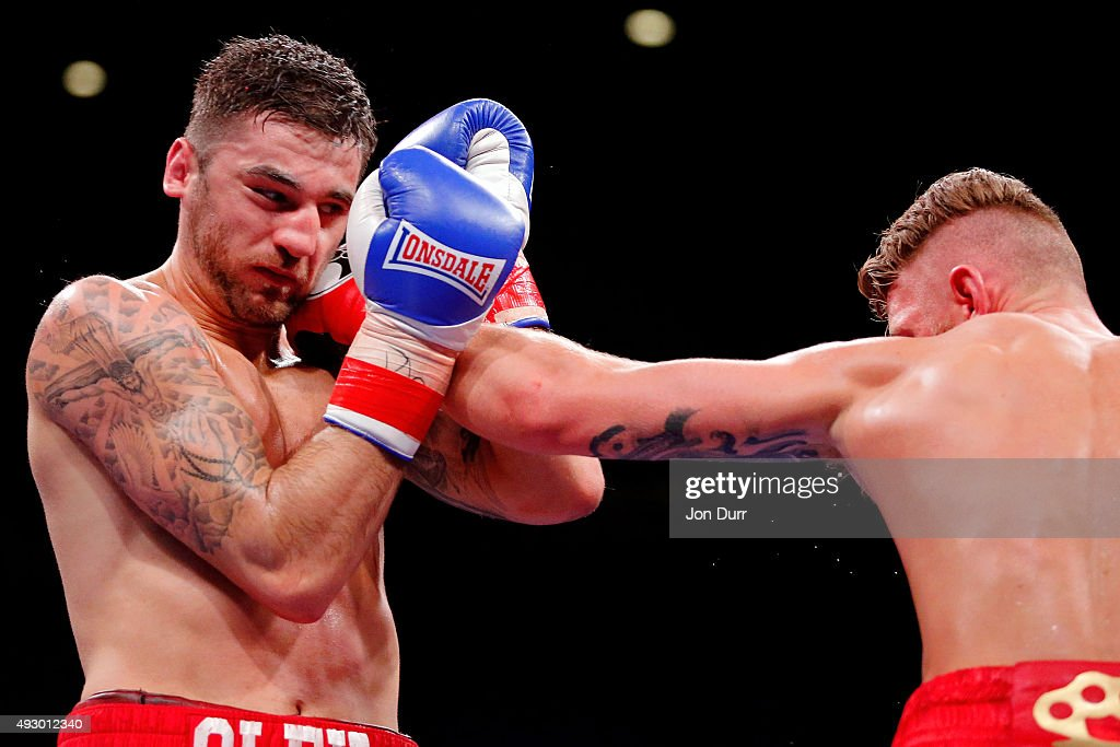 Andrzej Fonfara (R) throws a left at Nathan Cleverly during their Main Event: Light Heavyweights fight at UIC Pavilion on October 16, 2015 in Chicago, Illinois. Andrzej Fonfara won by unanimous decision.