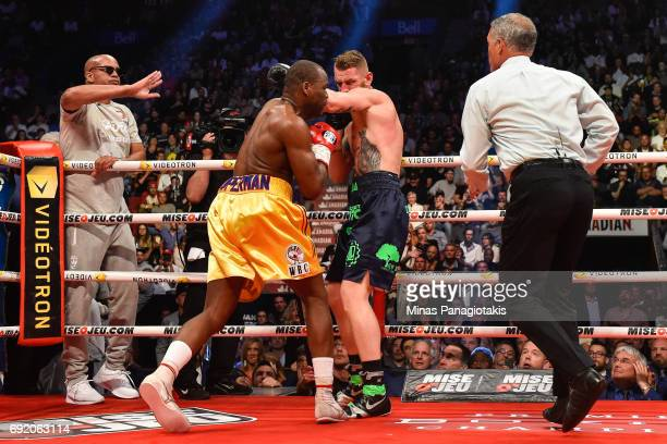 Andrzej Fonfara's trainer Virgil Hunter calls an end to the bout during the WBC light heavyweight world championship match against Adonis Stevenson...