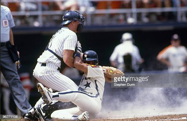 Andujar Cedeno of the Houston Astros slides into catcher Dan Walters of the San Diego Padres during their MLB game at Jack Murpy Stadium on May 23...