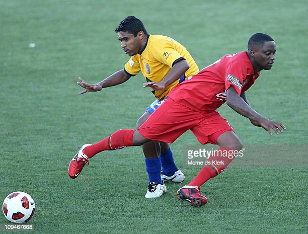 Andwele Slory of Adelaide and Anderson Alves Da Silva of the Gold Coast compete for the ball during the ALeague Semi Final match between Adelaide...