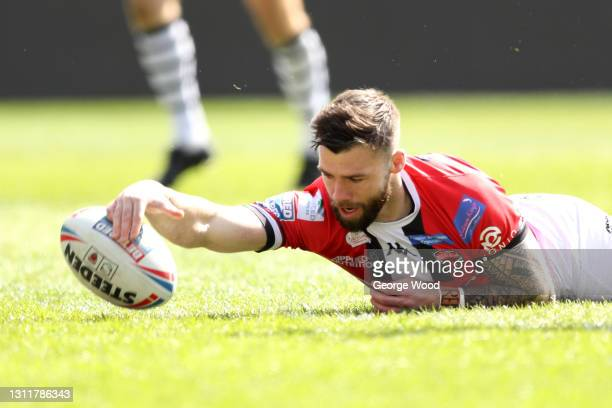 Andy Ackers of Salford Red Devils scores a try during the Betfred Challenge Cup match between Salford Red Devils and Widnes Vikings at AJ Bell...