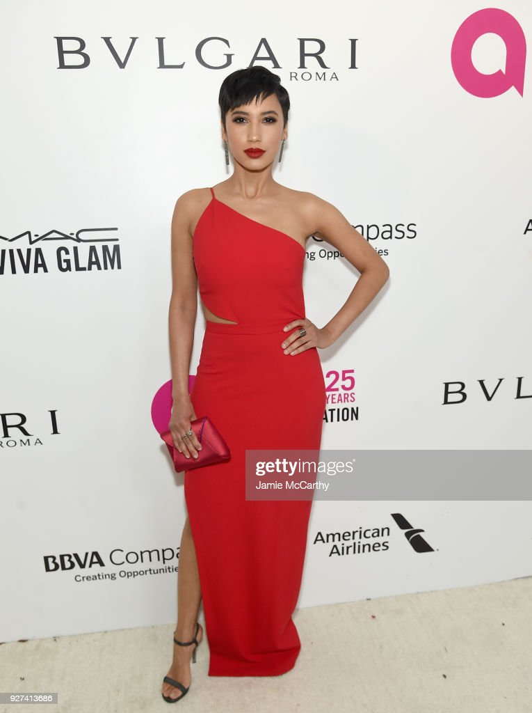 Andy Allo attends the 26th annual Elton John AIDS Foundation Academy Awards Viewing Party sponsored by Bulgari, celebrating EJAF and the 90th Academy Awards at The City of West Hollywood Park on March 4, 2018 in West Hollywood, California.