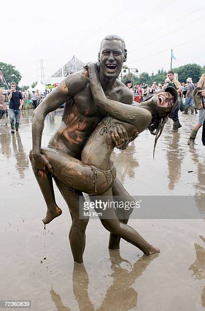 Andy and Liz from Yorkshire enjoy the first day of the Glastonbury Music Festival 2005 at Worthy Farm Pilton on June 24 2005 in Glastonbury England...