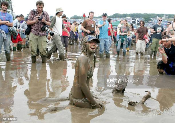 Andy and Liz from Yorkshire enjoys the first day of the Glastonbury Music Festival 2005 at Worthy Farm Pilton on June 24 2005 in Glastonbury England...