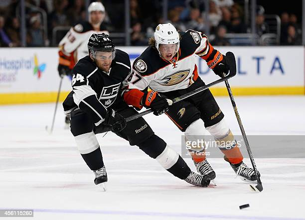 Andy Andreoff of the Los Angeles Kings and Rickard Rakell of the Anaheim Ducks fight for the puck in the third period at Staples Center on September...