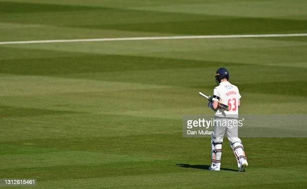 Andy Balbirnie of Glamorgan leaves the field dejected after being given out LBW to Ollie Robinson of Sussex during day one of the LV= County...