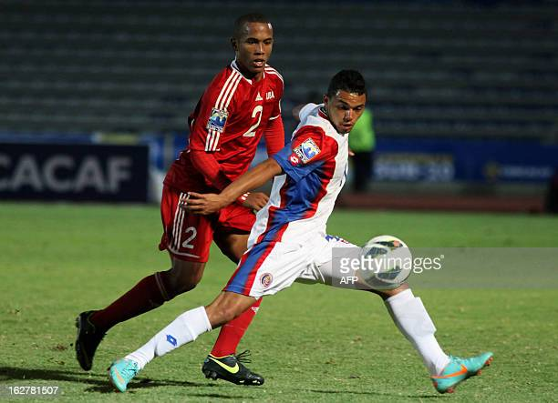 Andy Baquero of Cuba vies for the ball with Jhon Ruiz of Costa Rica during the 2013 FIFA Under20 Concacaf World Cup qualifier football match in...