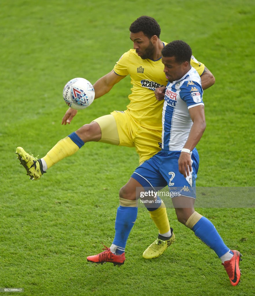 Andy Barcham of AFC Wimbledon battles with Nathan Byrne of Wigan Athletic during the Sky Bet League One match between Wigan Athletic and A.F.C. Wimbledon at DW Stadium on April 28, 2018 in Wigan, England.
