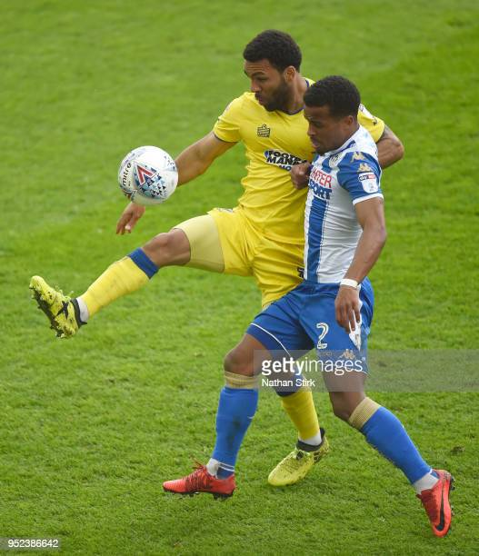 Andy Barcham of AFC Wimbledon battles with Nathan Byrne of Wigan Athletic during the Sky Bet League One match between Wigan Athletic and AFC...