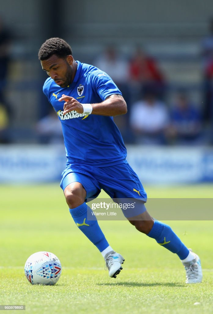 Andy Barcham of AFC Wimbledon in action during a pre-season friendly match between AFC Wimbeldon and Reading at The Cherry Red Records Stadium on July 7, 2018 in Kingston upon Thames, England.