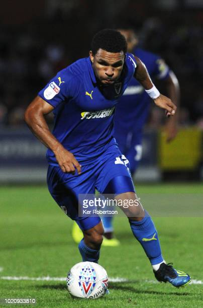 Andy Barcham of AFC Wimbledon in action during the Sky Bet League One match between AFC Wimbledon and Walsall at The Cherry Red Records Stadium on...