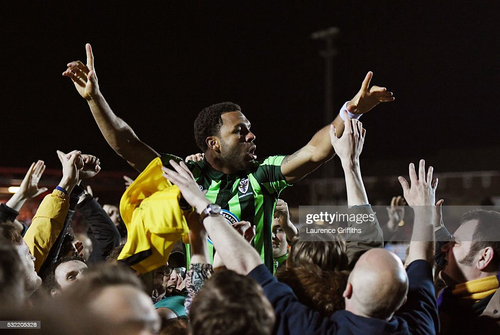 Andy Barcham of AFC Wimbledon is carried aloft by the fans after their team wins promotion to League One during the Sky Bet League Two play off, Second Leg match between Accrington Stanley and AFC Wimbledon at The Crown Ground on May 18, 2016 in Accrington, England.