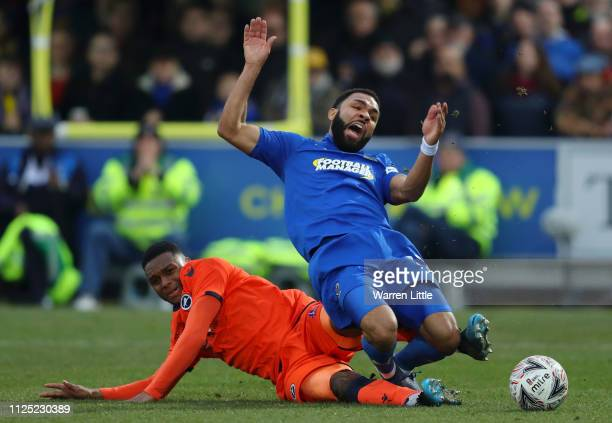 Andy Barcham of AFC Wimbledon is tackled by Mahlon Romeo of Millwall during the FA Cup Fifth Round match between AFC Wimbledon and Millwall at The...