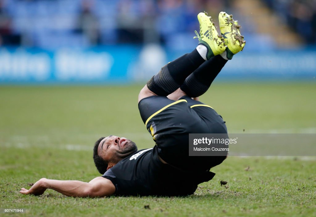 Andy Barcham of AFC Wimbledon takes a tumble during the Sky Bet League One match between Shrewsbury Town and AFC Wimbledon at New Meadow on March 24, 2018 in Shrewsbury, England.