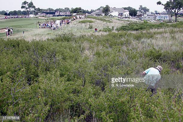 Andy Beam hits out of the deep rough on hole 7 during the final round of the US Senior Open at Prairie Dunes Country Club in Hutchinson Kansas on...
