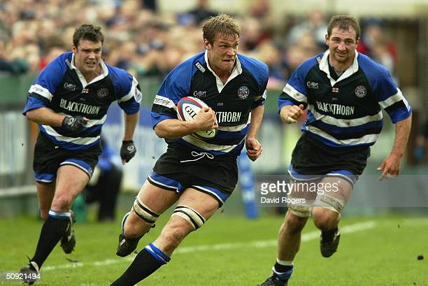 Andy Beattie of Bath attacks with support from teamates Martyn Wood and Steve Borthwick during the Zurich Premiership match between Bath and Sale...