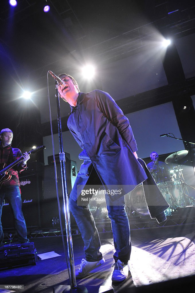 Andy Bell, Liam Gallagher and Chris Sharrock of Beady Eye performs on stage at O2 Academy on November 12, 2013 in Leeds, England.