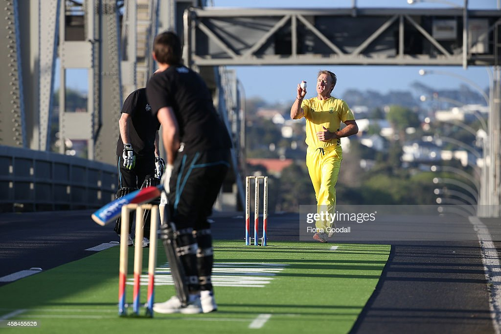 Andy Bichel bowls to Stephen Fleming on Auckland's Harbour Bridge, marking 100 days to go until the ICC Cricket World Cup 2015 which takes place in New Zealand and Australia starting February 2015, on October 26, 2014 in Auckland, New Zealand.