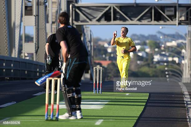 Andy Bichel bowls to Stephen Fleming on Auckland's Harbour Bridge, marking 100 days to go until the ICC Cricket World Cup 2015 which takes place in...