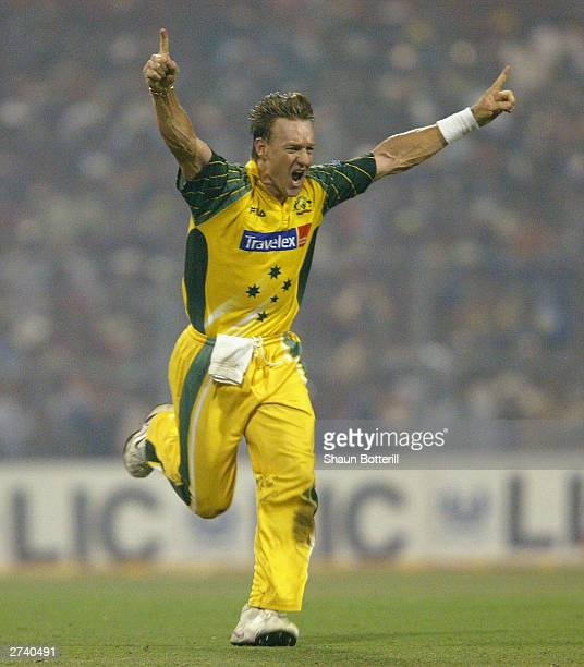 Andy Bichel of Australia celebrates the wicket of Sachin Tendulkar of India during the TVS Triangular One Day Series Final between India and...
