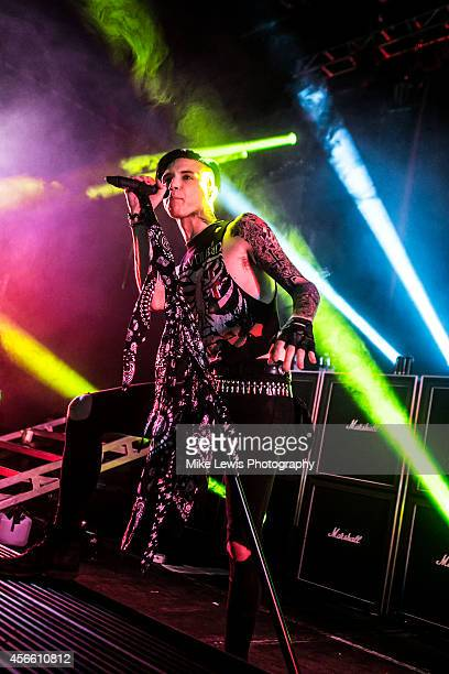 Andy Biersack of Black Veil Brides performs on stage at Cardiff University on October 3 2014 in Cardiff United Kingdom