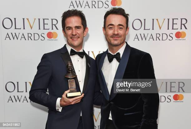 Andy Blankenbuehler winner of the Best Theatre Choreographer award for 'Hamilton' and Joe McFadden pose in the press room during The Olivier Awards...