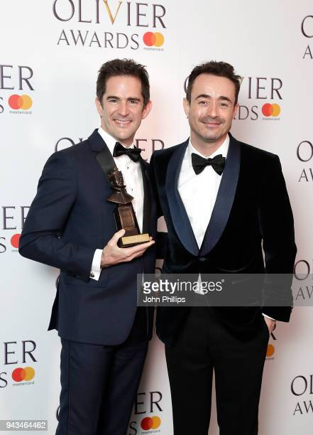 Andy Blankenbuehler winner of the Best Theatre Choreographer award for 'Hamilton' and poses with Joe McFadden in the press room during The Olivier...