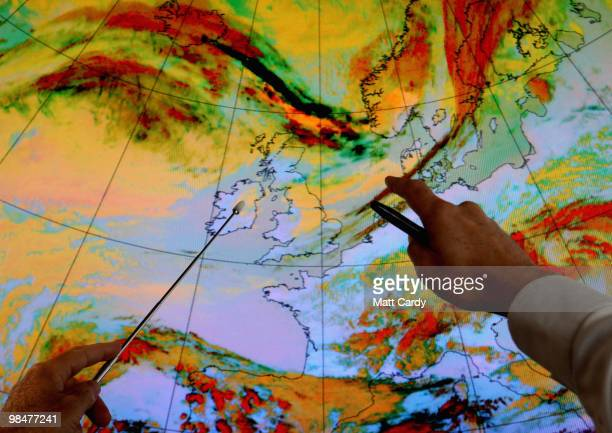 Andy Bodenham, Met Office Forecaster points at an enchanced colour satellite image highlighting a volcanic ash plume moving towards the United...