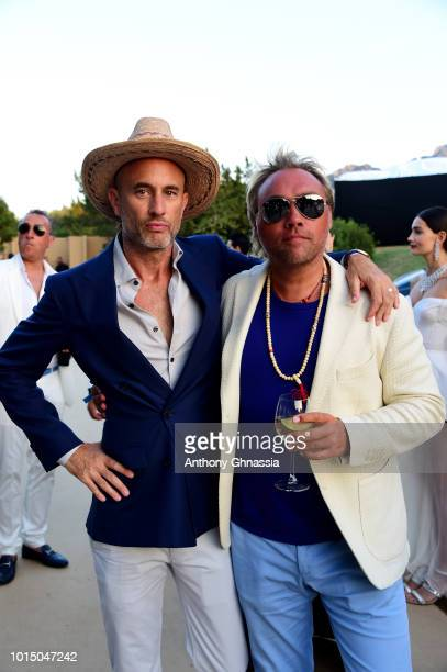 Andy Boose and Johan Ernst Nilson attend the Unicef Summer Gala Presented by Luisaviaroma cocktail party at Villa Violina on August 10 2018 in Porto...