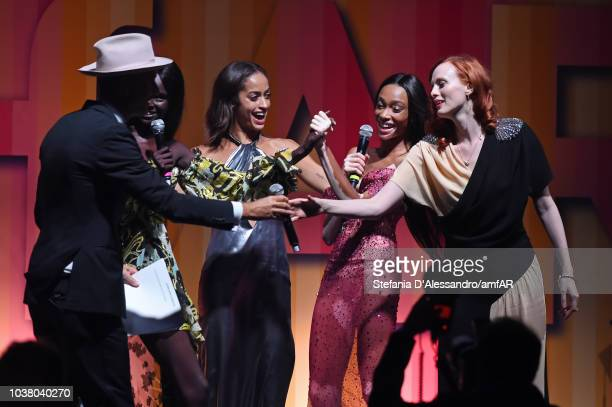 Andy Boose Duckie Thot Alanna Arrington Winnie Harlow and Karen Elson perform at the amfAR Gala dinner at La Permanente on September 22 2018 in Milan...