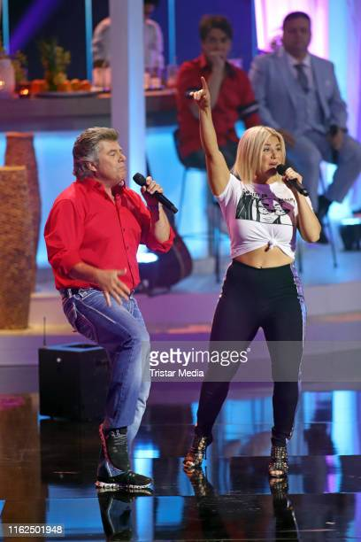 Andy Borg and Beatrice Egli during the television show Willkommen bei Carmen Nebel at BadenArena on July 13 2019 in Offenburg Germany
