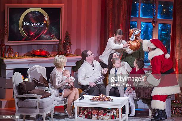 Andy Borg as Santa Borg hands over presents to Angelo Kelly and his family during the 'Heiligabend mit Carmen Nebel' TV show at Bavaria Filmstudios...