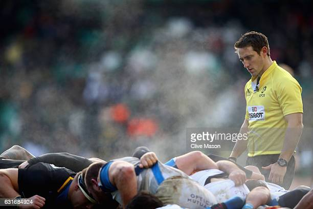 Andy Brace the referee oversees a scrum during the European Rugby Champions Cup match between Northampton Saints and Castres Olympique at Franklins...