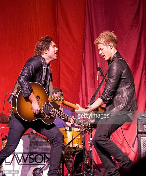 Andy Brown and Ryan Fletcher of Lawson perform on stage at LG Arena on March 1, 2012 in Birmingham, United Kingdom.