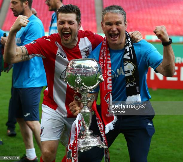 Andy Brown of Brackley Town and Coach Kevin Wilkin with Trophy during The Buildbase FA Trophy Final match between Brackley Town and Bromley at...