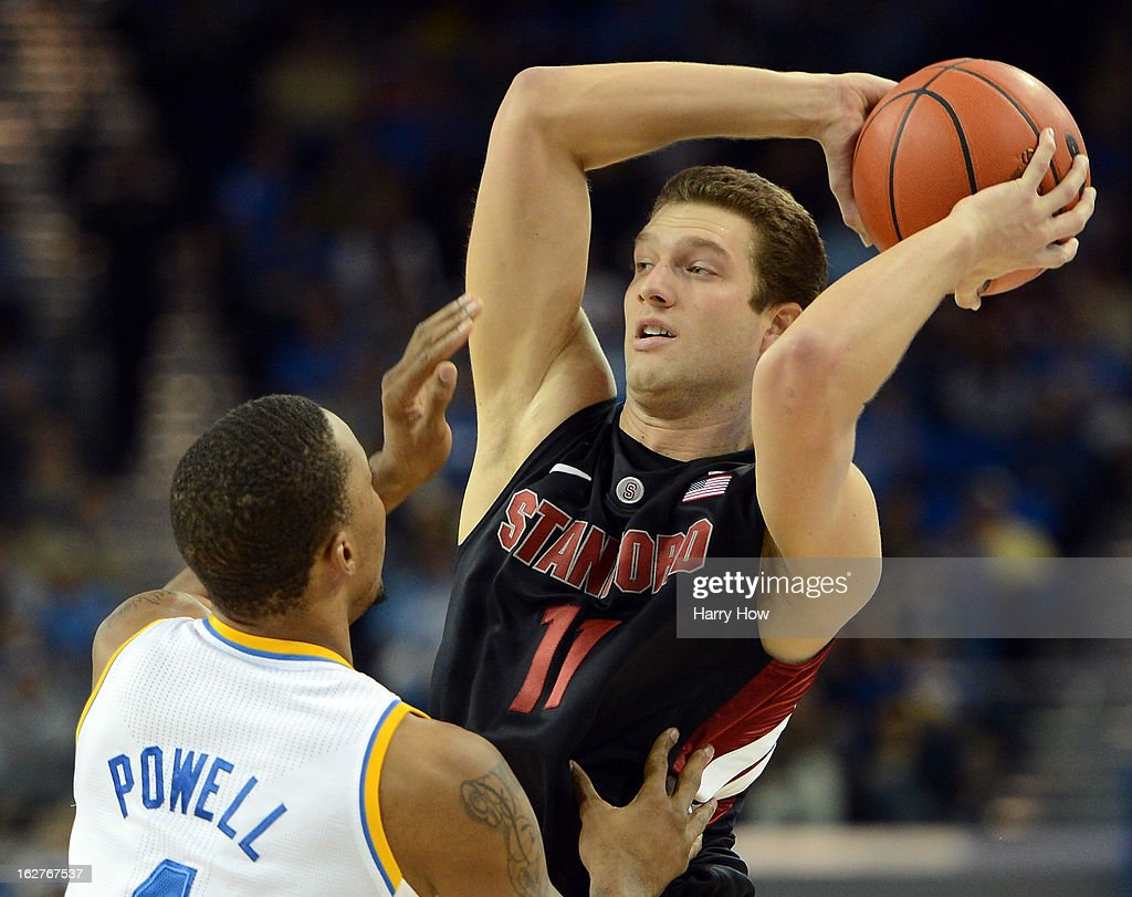 Andy Brown #11 of the Stanford Cardinal looks to pass against in front of Norman Powell #4 of the UCLA Bruins at Pauley Pavilion on January 5, 2013 in Los Angeles, California.