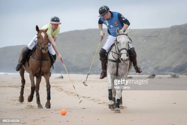 Andy Burgess riding Tonka and Daniel Loe riding La Sofia practice for the forthcoming Aspall Polo on the Beach at Watergate Bay on March 29 2017 in...